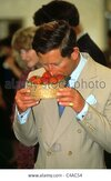 prince-charles-smelling-a-basket-of-strawberries-C4AC54.jpg